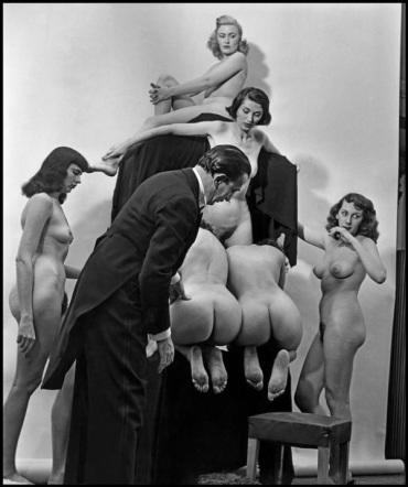 women forming skull dali
