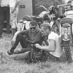 1964, Erfurt, Germany -- Steve McQueen smokes a cigarette during a rest as he took part in the international motorcycle race Six Days on his Triumph with the number 278.  Photo, Dieter Demme