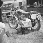 1964, Erfurt, Germany -- Steve McQueen rolls a cigarette during a rest as he took part in the international motorcycle race Six Days on his Triumph with the number 278. Photo, Dieter Demme